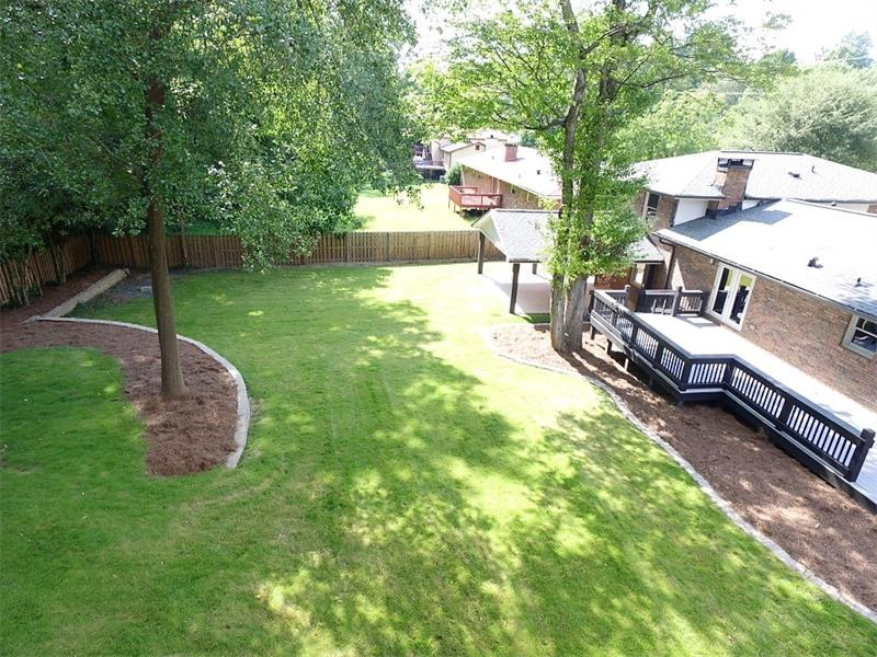 Great fenced back yard with deck and covered patio!