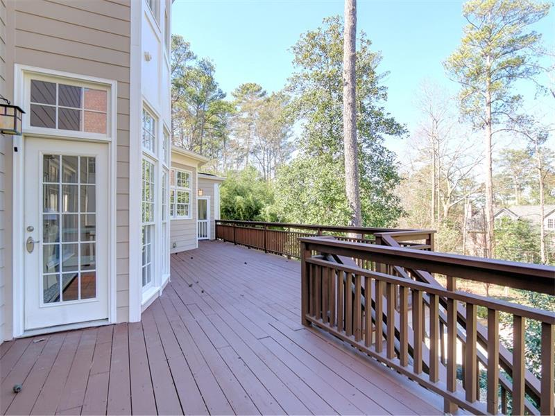 Large deck the length of the home, overlooking beautiful pool and Koi Pond in natural setting.