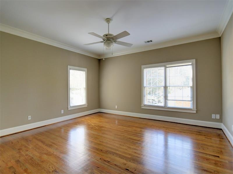 Large upstairs bedroom with hardwood.