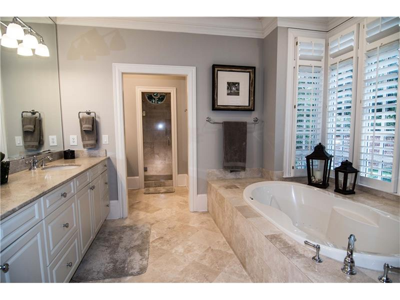 Large master bath with jetted tub, two sinks, separate make-up desk and large shower. All fixtures brand new.
