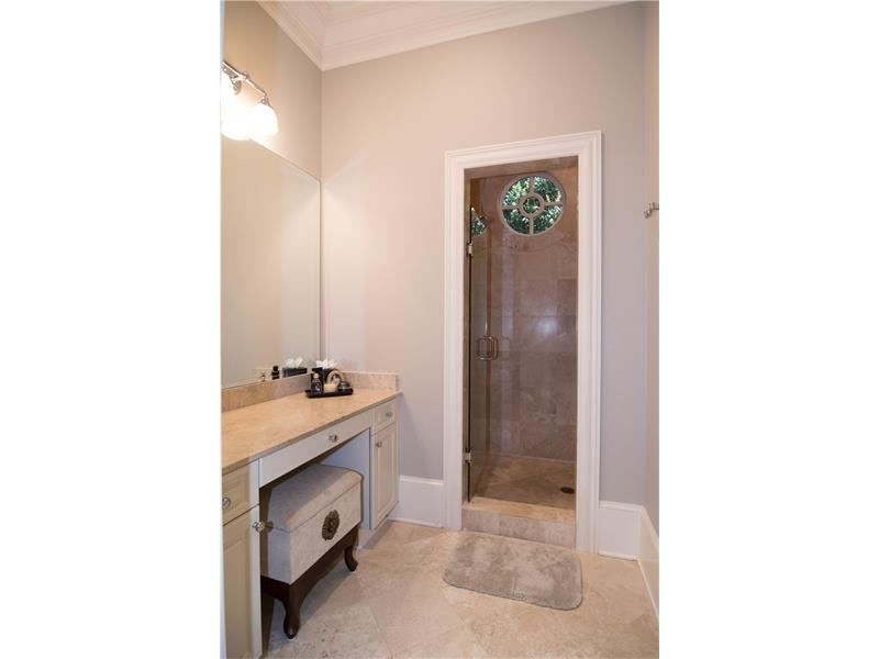 Convenient & separate sit-down make-up area in master bath.
