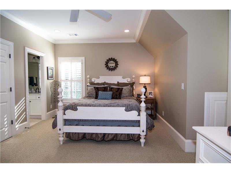 Upstairs bedroom 1 is huge with 2 walk-in closets and private sink. Shares toilet & shower with bedroom 2 (Jack 'n Jill).