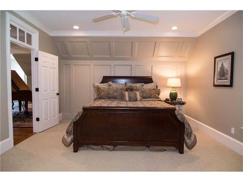 Upstairs bedroom 3 features a large walk-in closet and private bathroom.