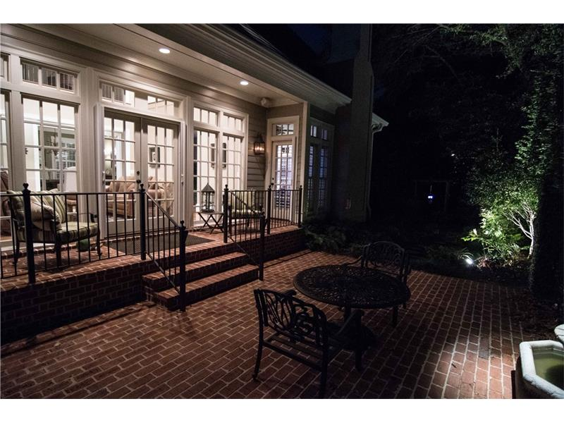 Rear covered porch & patio. Fountain and other features are lit for the enjoyment of your guests. Fountain pump and lights are on programmable timers.