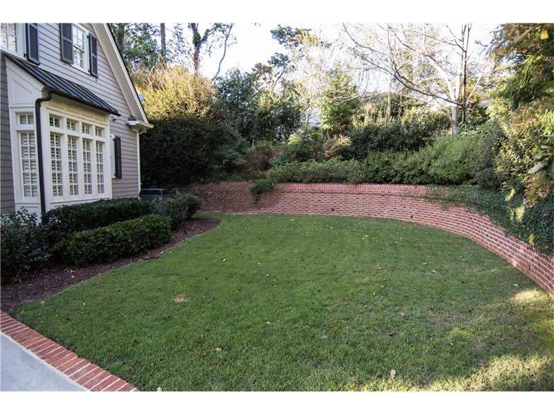 East side yard surrounded by brick wall. New Jamur Zoysia sod installed 4/17. Rear garden area and West side yard are fenced. Bay window is master bath tub.