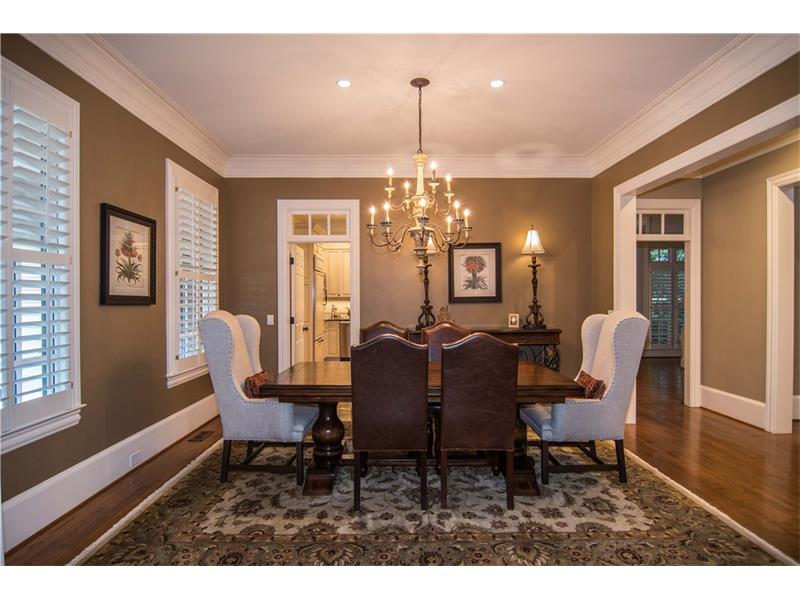 Formal dining room with easy kitchen access. Plantation shutters on every level.
