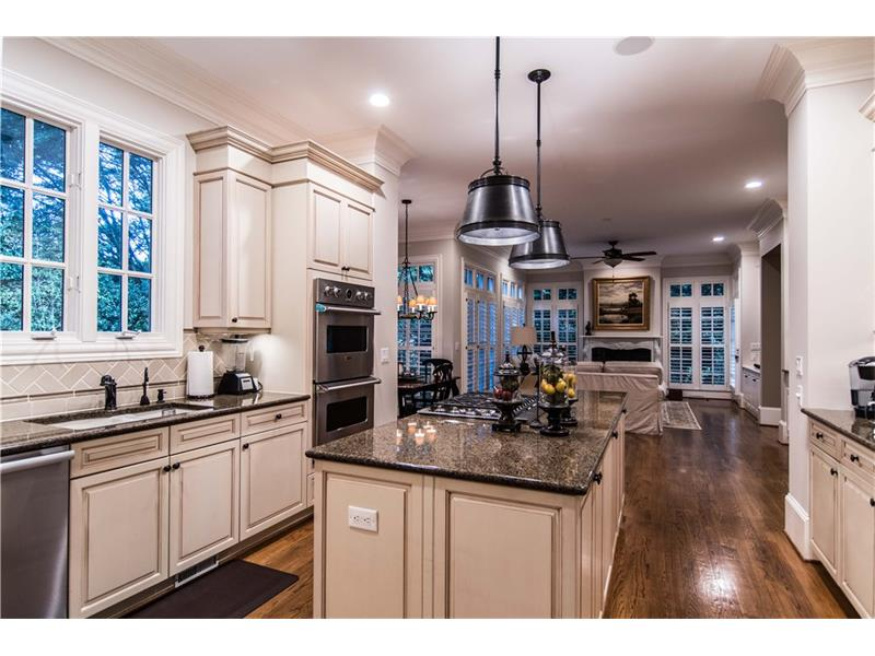 Viking Pro cooktop, downdraft exhaust, double ovens, warming drawer and microwave. Miele dishwasher & SubZero. Lots of cabinet space plus a pantry. Multi piece crown molding & LED can lights.