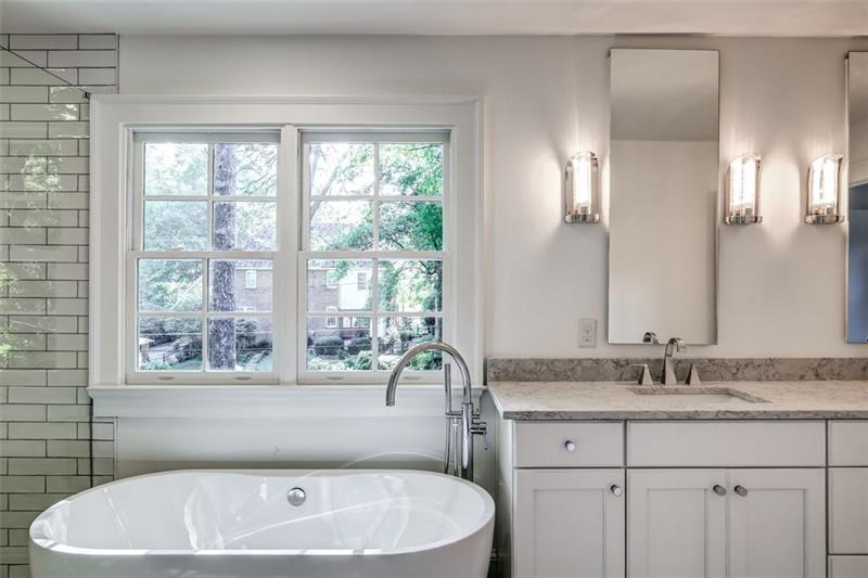 Master Bath with double vanity, stone countertops, separate tub and shower and water closet