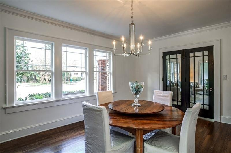 Dining Room with original four square French Doors; hardwoods throughout main floor
