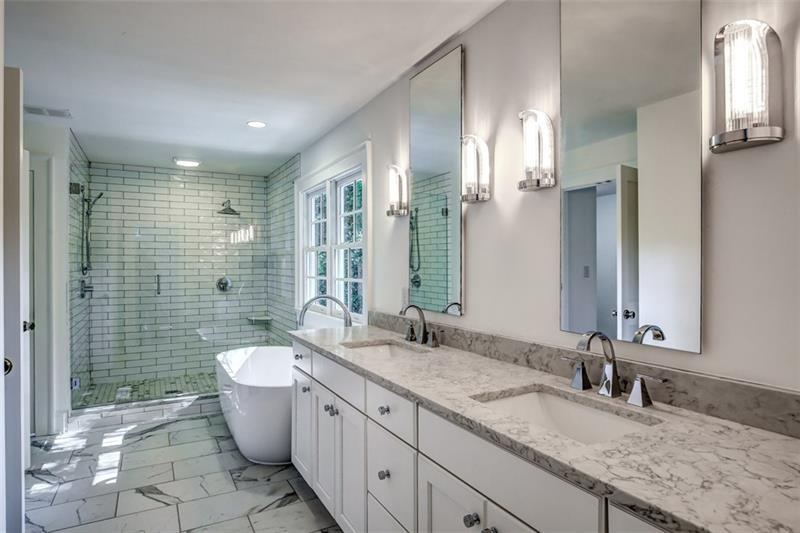 Private Master Bath with double vanilty/stone countertops, separate tub and shower and walk-in closet