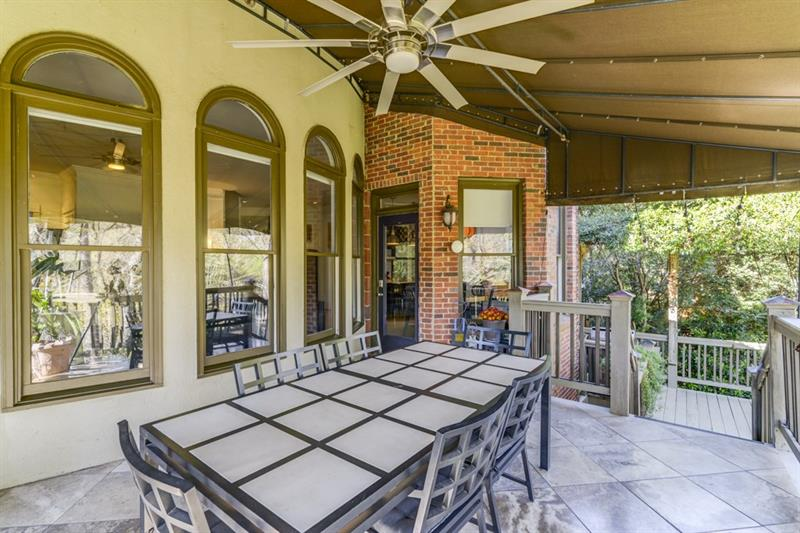 Main level patio has direct access to lower level entertaining space and expansive backyard.