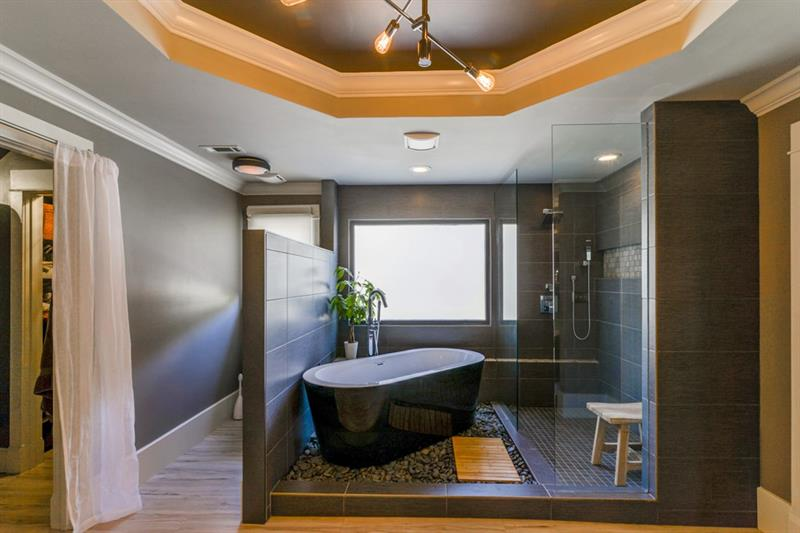 Luxurious soaking tub and shower.