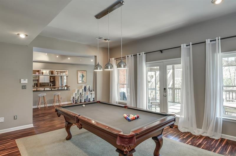 Billards Room located in lower level with access to screened in porch for relaxing and entertaining.